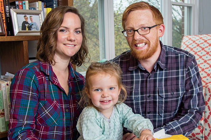 Kelly Pruden Grassi '08, a fundraiser for The Nature Conservancy, with her husband, Mark, and daughter, Fiona.