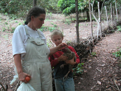 Linny Blumer '89 and son Matti, now 17, on their land in a remote section of Brazil.