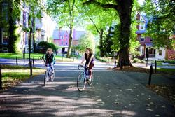 Students ride their bikes on campus.