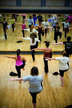 Smith MFA  dance student leading a class.